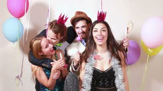 Group of funny crazy friends in photo booth