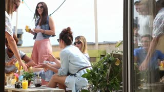 Group of people hanging out at rooftop party