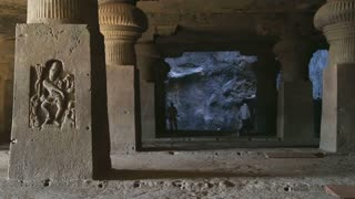 Halls and columns with relievos in Aurangabad caves.