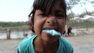 HAMPI, INDIA - 28 JANUARY 2015: Adorable indian girl making faces in front of camera.