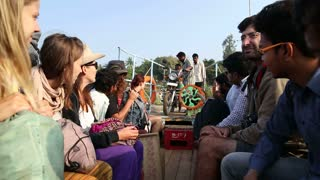 HAMPI, INDIA - 28 JANUARY 2015: Close view group of tourists and locals sitting on taxi boat.