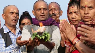 HAMPI, INDIA - 28 JANUARY 2015: Indian people burning herbs on the riverbank as a purification ritual.