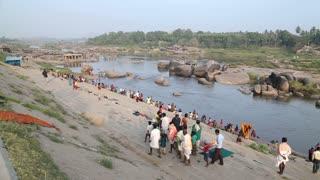 HAMPI, INDIA - 28 JANUARY 2015: People on the Tungabhadra river in Hampi.