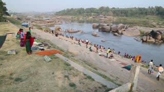 HAMPI, INDIA - 28 JANUARY 2015: People on the Tungabhadra river in Hampi.