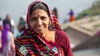 HAMPI, INDIA - 28 JANUARY 2015: Portrait of indian woman on the Tungabhadra river.