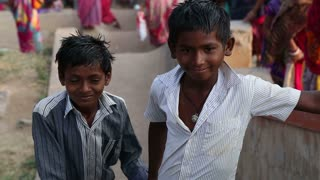 HAMPI, INDIA - 28 JANUARY 2015: Portrait of two smiling indian boys on the river.
