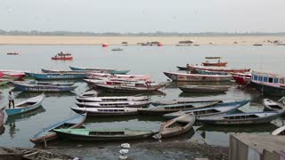 High angle view on anchored boats in bay of Ganges river in Varanasi.