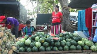 HIKKADUWA, SRI LANKA - FEBRUARY 2014: Locals standing and selling fruit at Hikkaduwa market. Hikkaduwa Sunday market is known for its wide range of supplies.