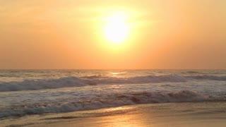 HIKKADUWA, SRI LANKA - FEBRUARY 2014: The view of the ocean waves on Hikkaduwa beach at sunset. Hikkaduwa is famous for its beautiful beaches.