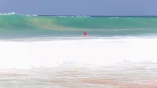 HIKKADUWA, SRI LANKA - FEBRUARY 2014: View of surfer ducking wave. Hikkaduwa is famous for its beautiful beaches.