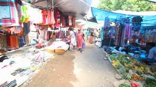 HIKKADUWA, SRI LANKA - FEBRUARY 2014: Walking through Hikkaduwa market. Hikkaduwa Sunday market is known for its wide range of supplies.