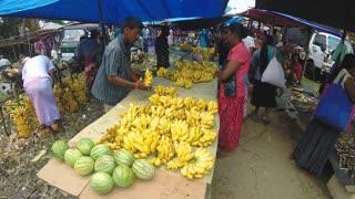 HIKKADUWA, SRI LANKA - MARCH 2014: Local man selling fresh fruits at the Sunday market.