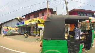 HIKKADUWA, SRI LANKA - MARCH 2014: Slow motion of streets in Sri Lanka on a summer day