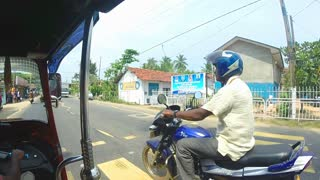 HIKKADUWA, SRI LANKA - MARCH 2014: Slow motion sequence of driving vehicle and motorcycle on the road in Hikkaduwa.