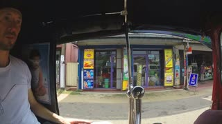 HIKKADUWA, SRI LANKA - MARCH 2014: Slow motion sequence of view from tuktuk on the streets of Sri Lanka