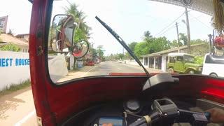 HIKKADUWA, SRI LANKA - MARCH 2014: View from tuktuk on the colorful streets of Hikkaduwa
