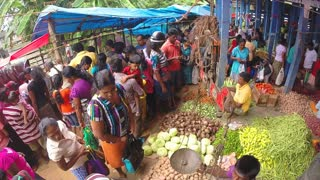 HIKKADUWA, SRI LANKA - MARCH 2014: View of busy and crowded Sunday market with fresh produce.