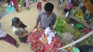 HIKKADUWA, SRI LANKA - MARCH 2014: View of man selling Incense sticks in large basket at the Sunday market.