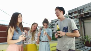 Hipster man drinking champagne with beautiful female friends