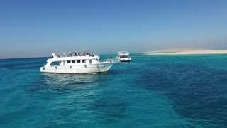 HURGHADA, EGYPT - FEBRUARY 13, 2016: Tourist excursion boat sailing towards Paradise island in the Red sea