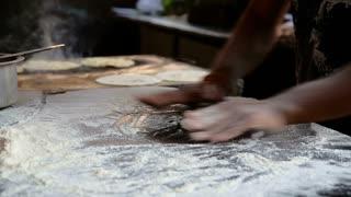 Indian man preparing dough for naan in workshop in Mumbai.
