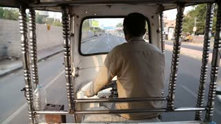 JODHPUR, INDIA - 11 FEBRUARY 2015: Back view of rickshaw driver during the ride through street in Jodhpur.