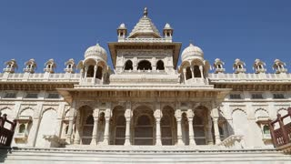 JODHPUR, INDIA - 11 FEBRUARY 2015: Facade of Jaswant Thada temple, with people passing aside.