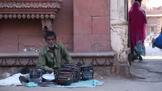 JODHPUR, INDIA - 11 FEBRUARY 2015: Portrait of local vendor selling pots at street in Jodhpur.