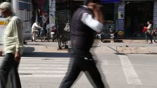 JODHPUR, INDIA - 11 FEBRUARY 2015: Timelapse of people and vehicles passing by the street crossroads in Jodhpur.