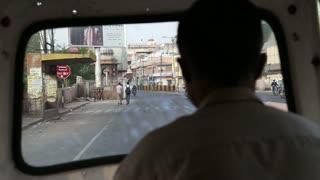 JODHPUR, INDIA - 11 FEBRUARY 2015: Window view at street of Jodhpur during the ride in rickshaw.