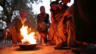 JODHPUR, INDIA - 12 FEBRUARY 2015: Local Indian people gathered around the fire at street in Jodhpur.