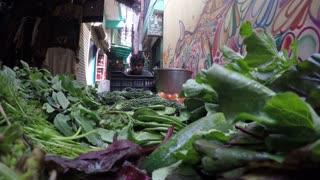 JODHPUR, INDIA - 12 FEBRUARY 2015: Man transporting vegetables on wheelbarrow through street.