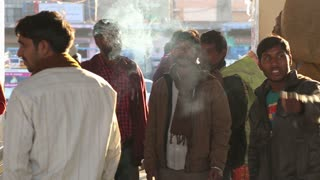 JODHPUR, INDIA - 12 FEBRUARY 2015: Portrait of group of Indian men smoking cigarettes at market in Jodhpur.