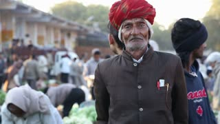 JODHPUR, INDIA - 12 FEBRUARY 2015: Portrait of old Indian man in formal clothing at market in Jodhpur.