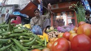 JODHPUR, INDIA - 12 FEBRUARY 2015: Vendor weighing vegetables at market in Jodhpur.