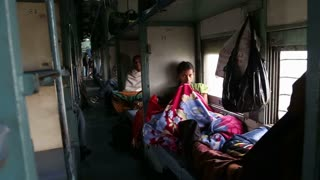 JODHPUR, INDIA - 13 FEBRUARY 2015: View on hall with people in train beds during a train ride.