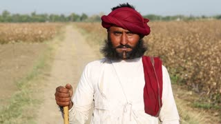 JODHPUR, INDIA - 14 FEBRUARY 2015: Portrait of local Indian man with unique beard at field road in Jodhpur.