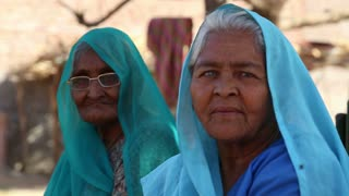 JODHPUR, INDIA - 14 FEBRUARY 2015: Portrait of two old Indian women in traditional colorful clothing.