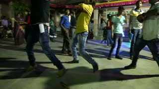 JODHPUR, INDIA - 15 FEBRUARY 2015: Young Indian men dancing in crowd at street in Jodhpur.