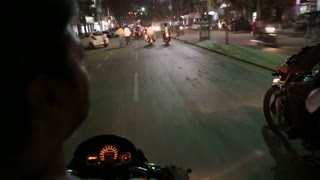 JODHPUR, INDIA - 17 FEBRUARY 2015: Timelapse of motorbike driver riding down the busy streets in Jodhpur.