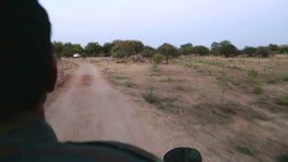 JODHPUR, INDIA - 20 FEBRUARY 2015: View on back on motorcycle taxi in desert around Jodhpur.
