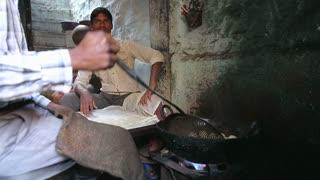 JODHPUR, INDIA - 5 FEBRUARY 2015: Man preparing traditional indian food.