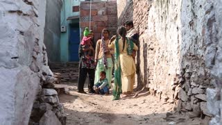 JODHPUR, INDIA - 5 FEBRUARY 2015: View of women in traditional clothing standing in street.