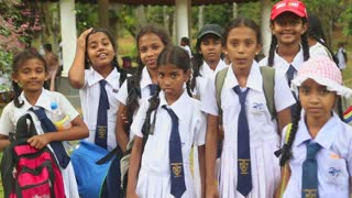KANDY, SRI LANKA - FEBRUARY 2014: The view of local school girls posing in the Botanical Garden in Kandy. Kandy is a major city in Sri Lanka, second biggest after Colombo.