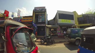 KANDY, SRI LANKA - FEBRUARY 2014: View of traffic from moving vehicle.