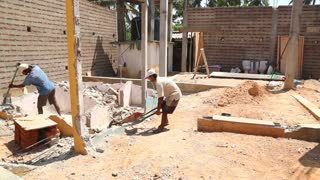 KOSGODA, SRI LANKA - MARCH 2014: Local construction workers labouring on building site.