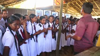KOSGODA, SRI LANKA - MARCH 2014: School girls visiting Kosgoda turtle hatchery. The conservation protect aims to educate children on nature and environment.
