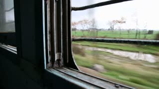Landscape view through the window during a train ride in Amritsar.