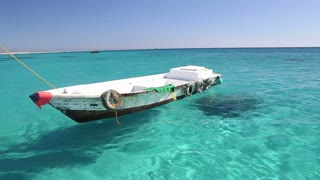 Little wooden boat floating in the Red sea, Egypt