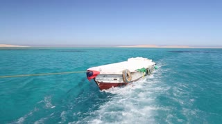 Little wooden boat in the Red sea, Egypt